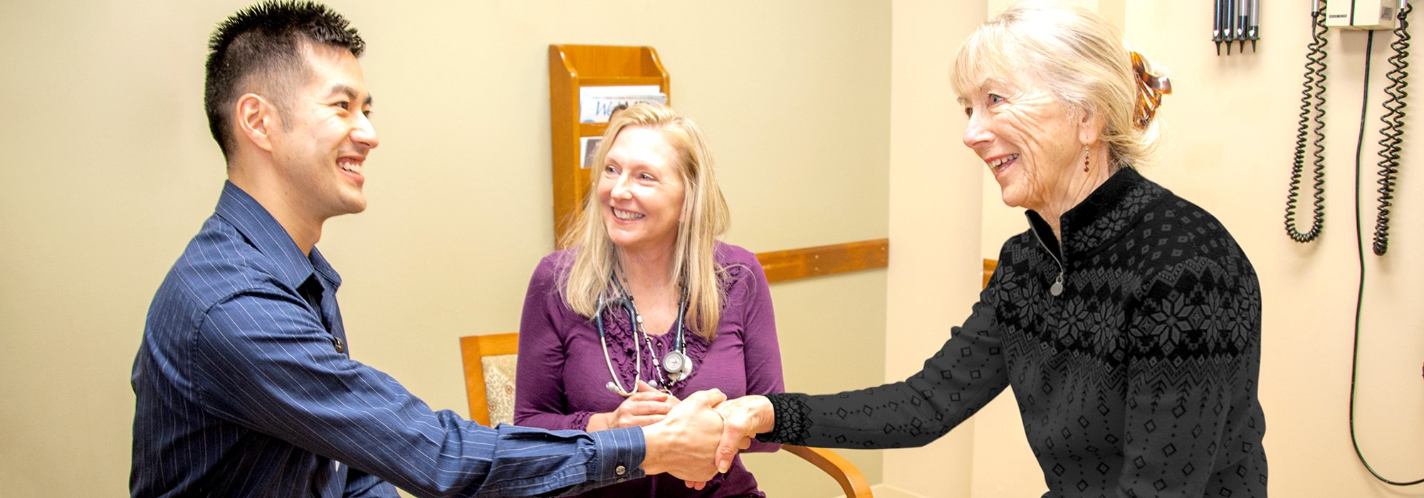 Dr. Maxwell Moholy, Behavioral Health Consultant, with Chronic Care Coordinator Christiane Brown and a patient.