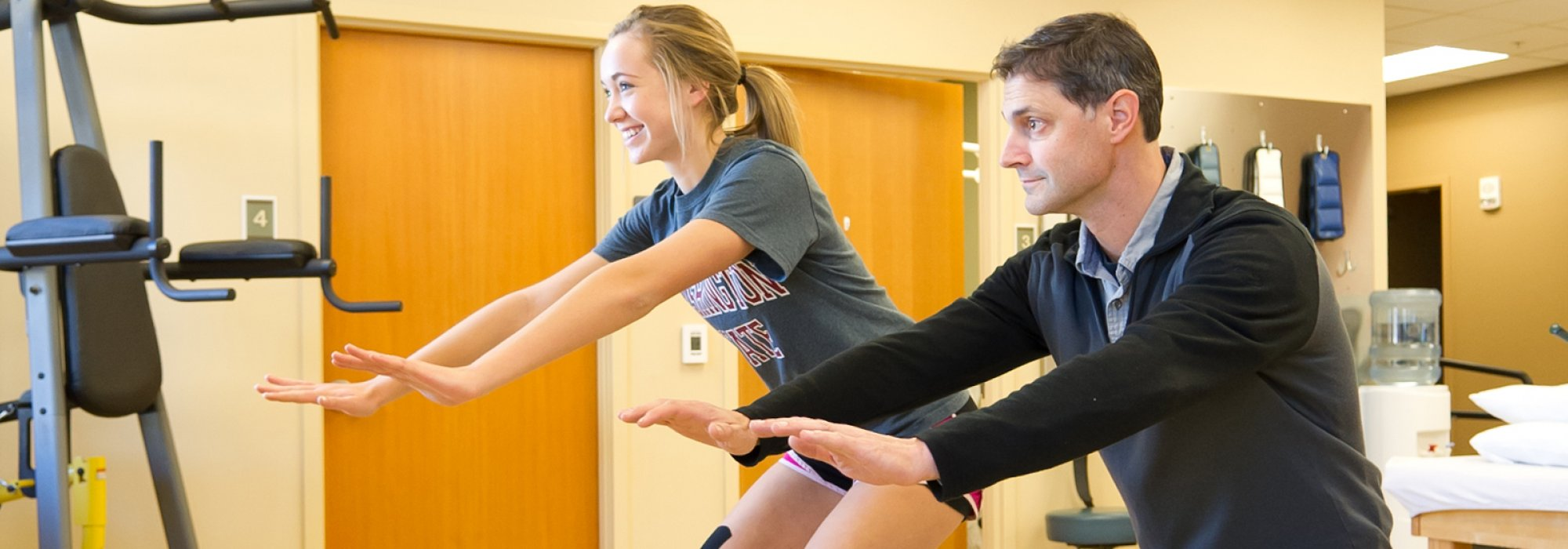 Physical Therapist Chris Allen works with Makenna, a high school athlete.