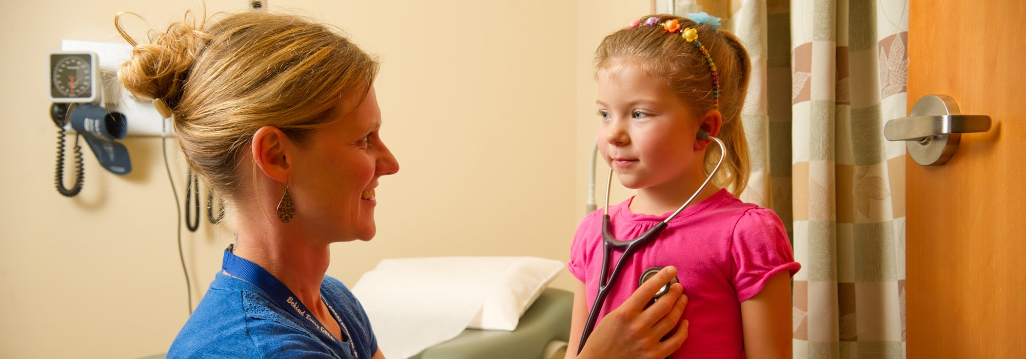 Carrie Kingsley, ARNP, checks the heartbeat of a pediatric patient.